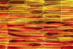 Tubo de vidro vermelho e alaranjado abstrato Foto de Stock Royalty Free