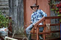 Tubo del fumo dell'uomo del cowboy Fotografia Stock Libera da Diritti