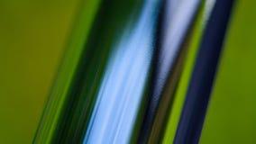 Tubo del metallo con il colpo colorato di macro di riflessioni Fotografia Stock
