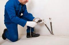 Tubo di acqua della riparazione dell'idraulico Fotografie Stock