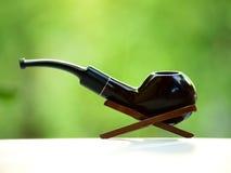 Tubo di fumo nel suo supporto Fotografia Stock
