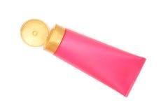 Tubo di plastica rosa con il coperchio giallo aperto del cappuccio Fotografia Stock