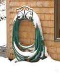Tubo flessibile di giardino in inverno Fotografia Stock
