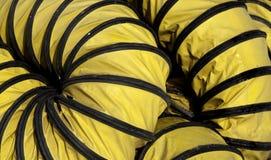 Tubo flessibile giallo flessibile Fotografie Stock