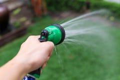 tubo flessibile o spruzzo dell'acqua Fotografie Stock
