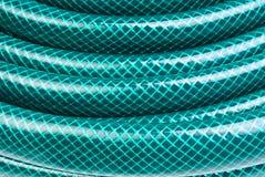 Tubo flessibile verde per innaffiare fotografia stock