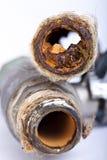 Tubos oxidados reventados Fotografía de archivo