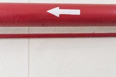 Tubo rosso con Directrion Fotografia Stock