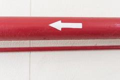 Tubo rosso con Directrion Fotografia Stock Libera da Diritti