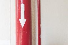 Tubo rosso con Directrion Immagine Stock Libera da Diritti