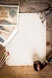 Tubo, vecchia carta e vecchi soldi Fotografia Stock Libera da Diritti