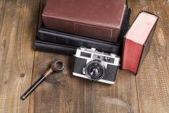 Tubo y libros Imagen de archivo libre de regalías