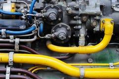 Tubo y válvula en el motor de jet fotografía de archivo