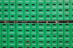 Tuborg beer package. CELAREVO, SERBIA - JUNE 11. 2017. Carlsberg Serbia brewery, heap of green crates for Tuborg beer at factory large warehouse royalty free stock photos