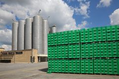 Tuborg beer package in factory. CELAREVO, SERBIA - JUNE 11. 2017. Carlsberg Serbia brewery, heap of green crates for Tuborg beer at large warehouse with storage royalty free stock images