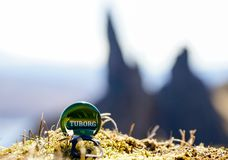 A Tuborg Bottle cap in front of the Old Man of Storr in Scotland. Isle of Skye royalty free stock photos