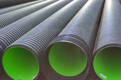 Tubos acanalados grandes del PVC para el drenaje Imagen de archivo libre de regalías