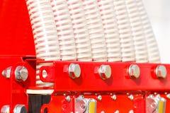 Tubos acanalados plásticos en la máquina agrícola, concepto de la tecnología Imagen de archivo