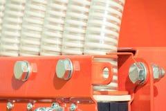 Tubos acanalados plásticos en la máquina agrícola, concepto de la tecnología Fotografía de archivo libre de regalías