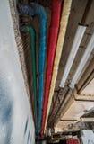 Tubos coloreados viejos Foto de archivo libre de regalías