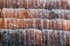 Tubos da rotação doce da massa em um fogo aberto fotografia de stock royalty free