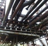Tubos de aceite oxidados viejos Fotografía de archivo libre de regalías