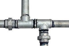 Tubos de agua del metal en un blanco Imagen de archivo