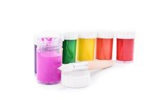 Tubos de ensaio da cor com uma escova Imagens de Stock