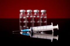 Tubos de ensaio e seringa médicos Imagem de Stock Royalty Free