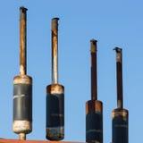 Tubos de escape viejos del metal Foto de archivo libre de regalías