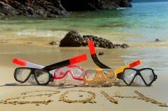 Tubos de respiração e ano novo 2014 na praia Imagens de Stock