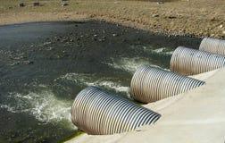 Tubos del drenaje en una central eléctrica Imágenes de archivo libres de regalías