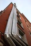 Tubos del metal en la pared Imagen de archivo libre de regalías