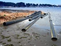 Tubos en el agua Fotos de archivo libres de regalías