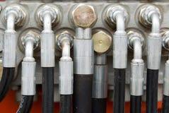 Tubos hidráulicos en la maquinaria pesada Fotos de archivo libres de regalías