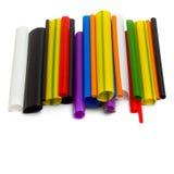 Tubos plásticos coloreados brillantes aislados Foto de archivo libre de regalías