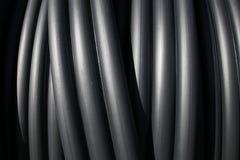 Tubos plásticos negros Imagenes de archivo