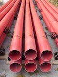 Tubos rojos del PVC Fotos de archivo