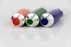 Tubos vermelhos, verdes, azuis da pintura no fundo branco Imagens de Stock Royalty Free