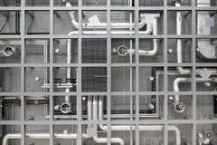 Tubos y ventiladores industriales en techo Fotos de archivo libres de regalías