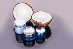 Tubs containing coconut oil are used as moisturizer for skin Stock Images
