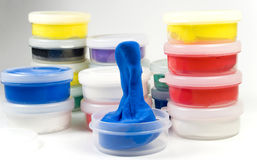 Tubs of modelling clay Stock Images