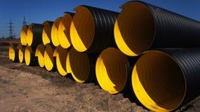 Tubulação amarela ondulada Imagens de Stock