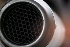 Tubulação de exaustão do detalhe do close-up da bicicleta grande Teste padrão original do hexágono de competir a tubulação de exa fotos de stock royalty free