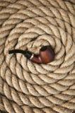 Tubulação do vintage na corda velha Fotografia de Stock Royalty Free