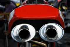 Tubulações de exaustão de competir o velomotor imagens de stock