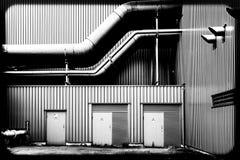 Tubulações de uma fábrica fotos de stock royalty free