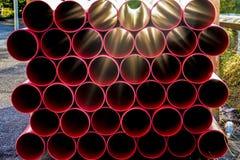 Tubulações para as tubulações plásticas vermelhas da construção Fotografia de Stock Royalty Free