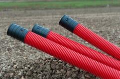 Tubulações plásticas onduladas vermelhas Imagens de Stock Royalty Free
