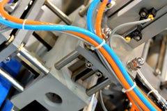 Tubulação colorida no equipamento Foto de Stock